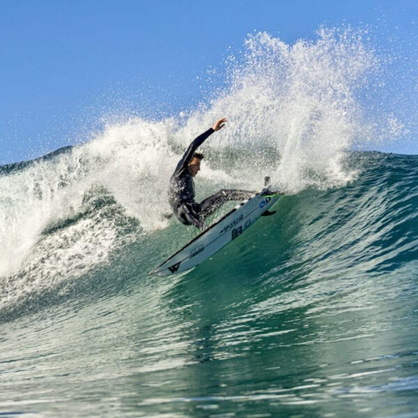 Surfer with Wildsuits eco wetsuit